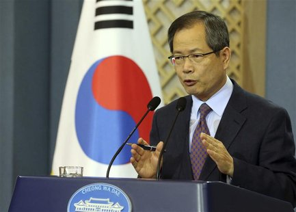 Chun Young-woo, top secretary to South Korean President Lee Myung-bak for foreign and security affairs, speaks to reporters at the president