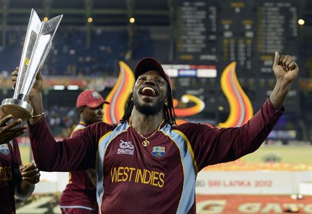 West Indies' Chris Gayle celebrates with the trophy after the West Indies defeated Sri Lanka in their World Twenty20 final cricket match at