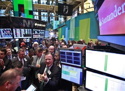 Traders await the Grupo Financiero Santander's first trade following it's IPO on the floor of the New York Stock Exchange, September 26, 201