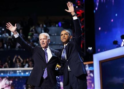 U.S. President Barack Obama (R) waves with Vice President Joe Biden after Obama accepted the 2012 U.S Democratic presidential nomination dur