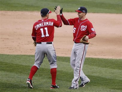 Washington Nationals' Ryan Zimmerman (L) and Adam LaRoche (R) celebrate after beating the St. Louis Cardinals in Game 1 of their MLB NLDS pl