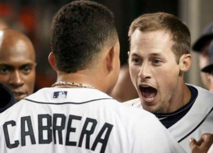 WALK OFF A HERO: Detroit Tigers' Don Kelly (R) celebrates with teammate Miguel Cabrera in MLB American League Division Series baseball playoff action in Detroit, Michigan. REUTERS/Rebecca Cook