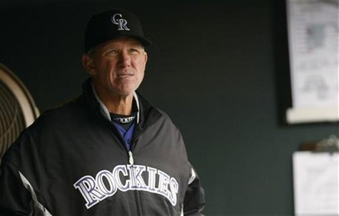 Colorado Rockies manager Jim Tracy reacts in the dugout after the Rockies pitched their seventh walk against the New York Mets in the fifth