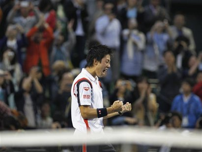 Kei Nishikori of Japan reacts after his win over Milos Raonic of Canada in the men's singles finals match at the Japan Open tennis champions
