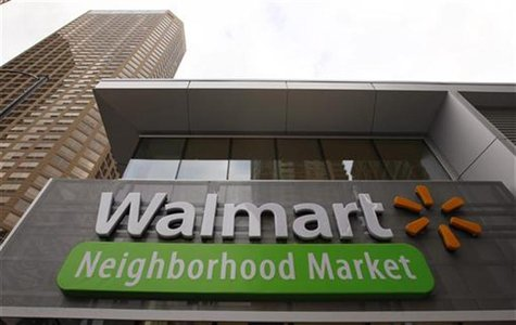 A Walmart Neighborhood Market sign is seen outside a newly opened store in Chicago September 21, 2011. The 27,000 square-foot store is the f
