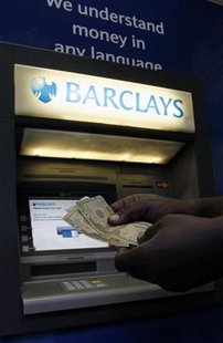 A man withdraws U.S. Dollar notes form a Barclays automated teller machine (ATM) in the capital Harare July 3, 2012. REUTERS/Philimon Bulawa