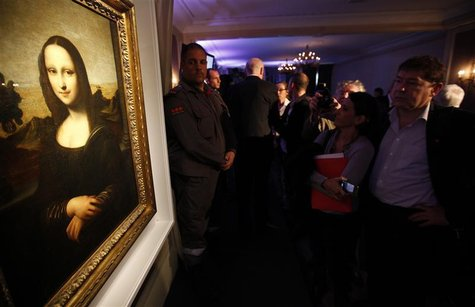 People look at a painting attributed to Leonardo da Vinci during a presentation in Geneva September 27, 2012. REUTERS/Denis Balibouse