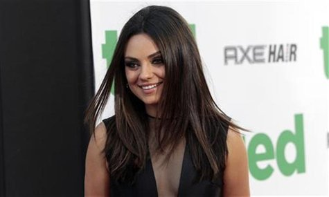 "Cast member Mila Kunis poses at the premiere of ""Ted"" at the Grauman's Chinese theatre in Hollywood, California June 21, 2012. The movie ope"