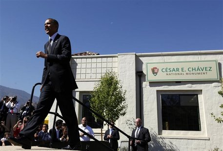 U.S. President Barack Obama walks out to speak at the Cesar E. Chavez National Monument in Keene, California, as part of his three day campa
