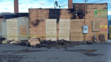The damage is a little more obvious in this view from the back of the building.