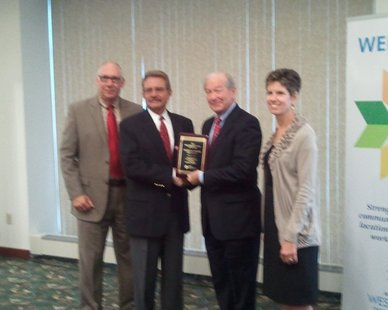 Doug Hekman (second from left) receives the 2012 Michigan West Coast Chamber of Commerce Small Business Person of the Year award from committee chair Skip Keener as Chamber Development Director Jim Schoettle (L) and President Jane Clark (R) look on at the Haworth Inn on Oct. 9, 2012.