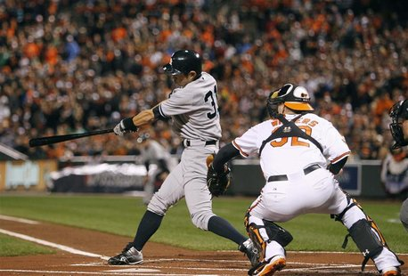 New York Yankees' Ichiro Suzuki hits an RBI double scoring Derek Jeter against the Baltimore Orioles in the first inning of Game 1 in their