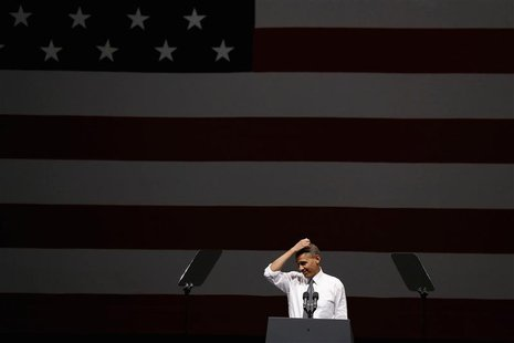 U.S. President Barack Obama gestures while speaking at an Obama Victory Fund concert while at the Bill Graham Civic Auditorium in San Franci