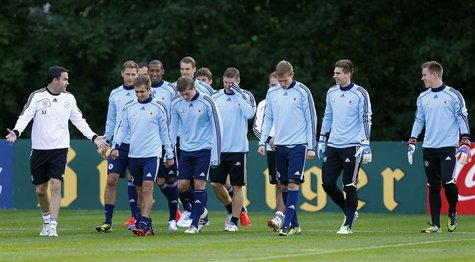 Ten players of Germany's national soccer team attend a practice session with athletic coach Shad Forsyth (L) in Frankfurt, October 9, 2012.