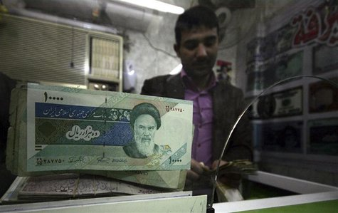 Iranian rial banknotes are seen at a currency exchange shop in Kerbala, 110 km (70 miles) south of Baghdad January 27, 2012. REUTERS/Mushtaq