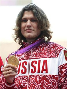 Russian's Ivan Ukhov holds up his gold medal for men's high jump in London at the London 2012 Olympic Games at the Olympic Stadium August 8,