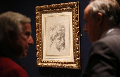 "Visitors look at Raphael's ""Auxiliary cartoon for the Head of a Young Apostle from 1519-1520 which has an estimated value of £10 to £15 mill"