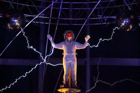 Magician David Blaine channels bolts of electricity from various tesla coils charged with one million volts of electricity during a stunt on
