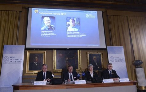 Pictures of the 2012 Nobel Prize for Physics laureates Serge Haroche (L) of France and David Wineland of the U.S. are displayed on a screen