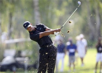 Tiger Woods of U.S. tees off on the 7th hole during his PGA World Golf Final Group 1 match against Charl Schwartzel of South Africa in Antal