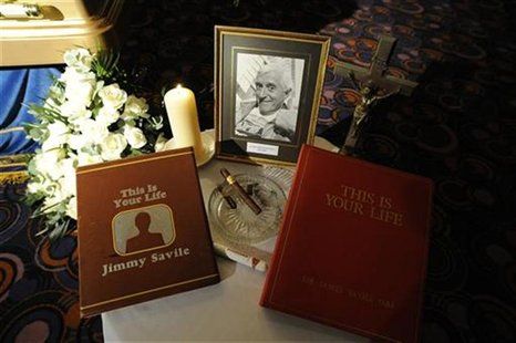 A tribute is seen next to the coffin of British entertainer Jimmy Saville as it is displayed to the public at The Queens Hotel in Leeds, nor