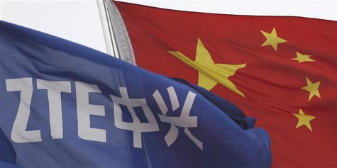A ZTE flag flutters in front of the Chinese national flag outside its headquarters in Shenzhen, Guangdong province in this April 17, 2012 fi