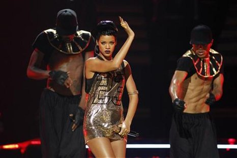 Singer Rihanna (C) performs with dancers during the 2012 iHeart Radio Music Festival at the MGM Grand Garden Arena in Las Vegas, Nevada Sept