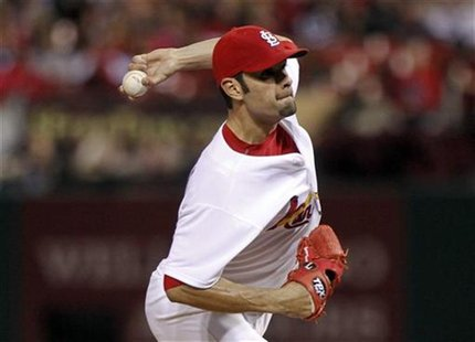 St. Louis Cardinals starting pitcher Jaime Garcia delivers a pitch to a Cincinnati Reds batter during the first inning of their MLB National