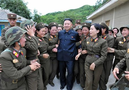 North Korean leader Kim Jong-un (C) visits the Thrice Three-Revolution Red Flag Kamnamu (persimmon tree) Company under the Korean People's A