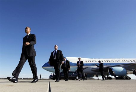U.S. President Barack Obama walks towards supporters after arriving at Rickenbacker Inland Port in Columbus, Ohio October 9, 2012, ending a