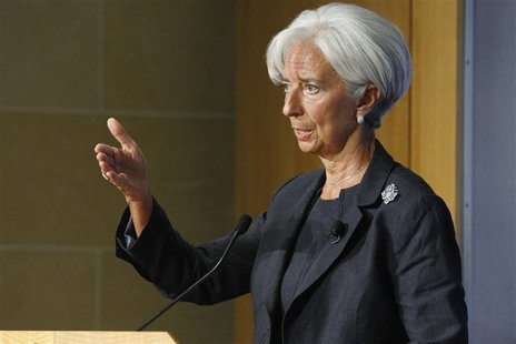 International Monetary Fund Managing Director Christine Lagarde gestures during her remarks on the state of the world economy at the Peterso