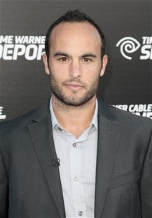 Major League Soccer (MLS) player Landon Donovan arrives at the Time Warner Cable Sports launch event for Time Warner Cable SportsNet and Tim