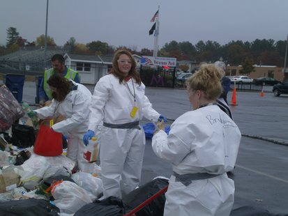 Mosinee High School Green Team members sorting recyclable materials from the garbage during a demonstration survey 10/9/12