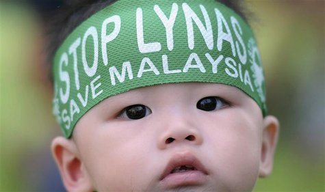 A child wears a headband during a protest against the construction of Australia's Lynas Corp earths plant in Gebeng, 270 km (168 miles) east