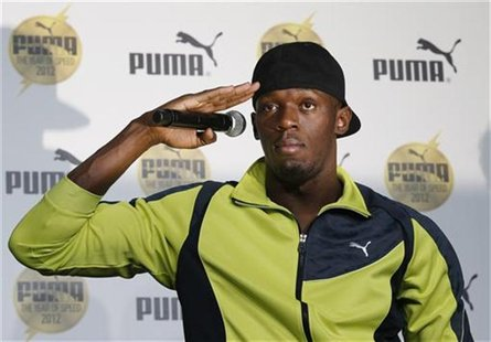 Jamaica's sprinter Usain Bolt gestures at a news conference in Tokyo October 10, 2012. REUTERS/Toru Hanai