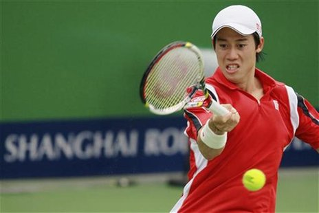 Kei Nishikori of Japan returns the ball to China's Wu Di during the Shanghai Masters men's singles tennis tournament in Shanghai October 9,