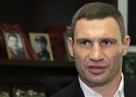 Heavyweight boxing champion and UDAR (Punch) party leader Vitaly Klitschko speaks during an interview at his office in Kiev October 8, 2012.