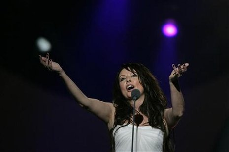 Sarah Brightman sings during the Live Earth concert near the Pearl tower at the new business district in Shanghai July 7, 2007. REUTERS/Aly