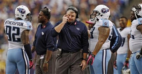 Tennessee Titans head coach Mike Munchak walks on the sidelines after Tennessee cornerback Coty Sensabaugh is called for an unnecessary roug
