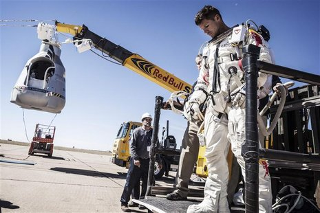 Pilot Felix Baumgartner of Austria leaves his capsule after his mission was aborted due to high winds in Roswell, New Mexico, in this Octobe