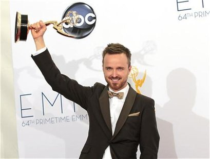 "Aaron Paul raises the Emmy award for outstanding supporting actor for a drama series for his role in ""Breaking Bad"" at the 64th Primetime Em"
