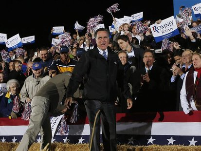 Republican presidential nominee Mitt Romney smiles as he arrives at a campaign rally outside the Cuyahoga Falls Natatorium in Cuyahoga Falls
