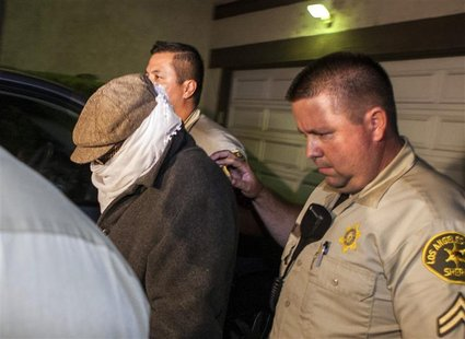 Nakoula Basseley Nakoula (L) is escorted out of his home by Los Angeles County Sheriff's officers in Cerritos, California September 15, 2012
