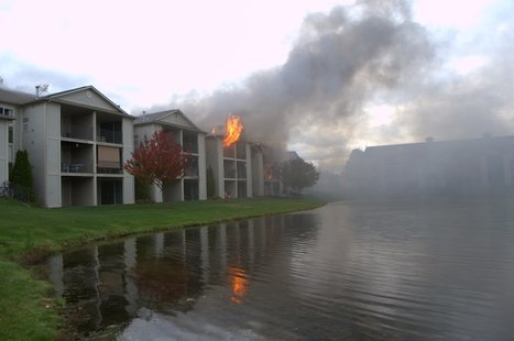 Flames shooting from apartment unit.  Photo Credit: Joel Oswald