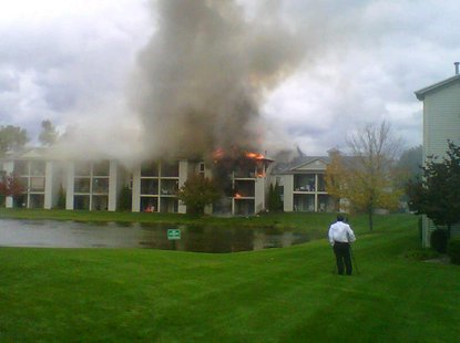 A fire burns through several of the units in Clearview Apartments in Holland, Michigan on Wednesday October 10th, 2012.