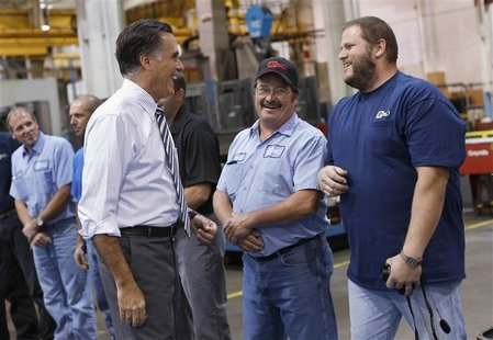 Republican presidential nominee Mitt Romney smiles while meeting members of the assembly line at Ariel Corporation before a town hall campai