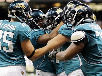 Jacksonville Jaguars wide receiver Kevin Elliott (87) celebrates with his team after scoring a touchdown late in the fourth quarter against