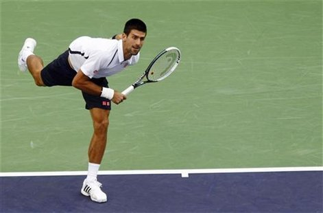 Serbia's Novak Djokovic serves against Spain's Feliciano Lopez during their singles tennis match at the Shanghai Masters tournament October
