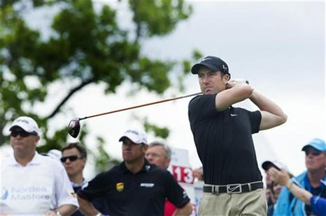 Britain's Ross Fisher tees off the first hole during the fourth and last round of the Nordea Masters golf tournament at Bro Hof golf club in