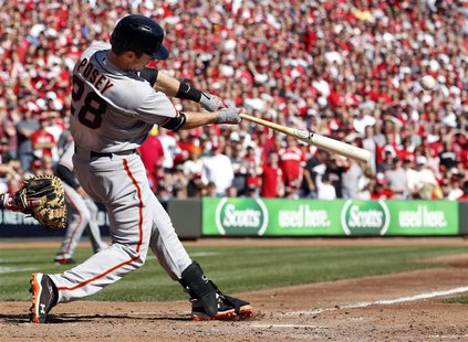 San Francisco Giants catcher Buster Posey hits a 5th inning grand slam home run against the Cincinnati Reds during Game 5 of their MLB NLDS